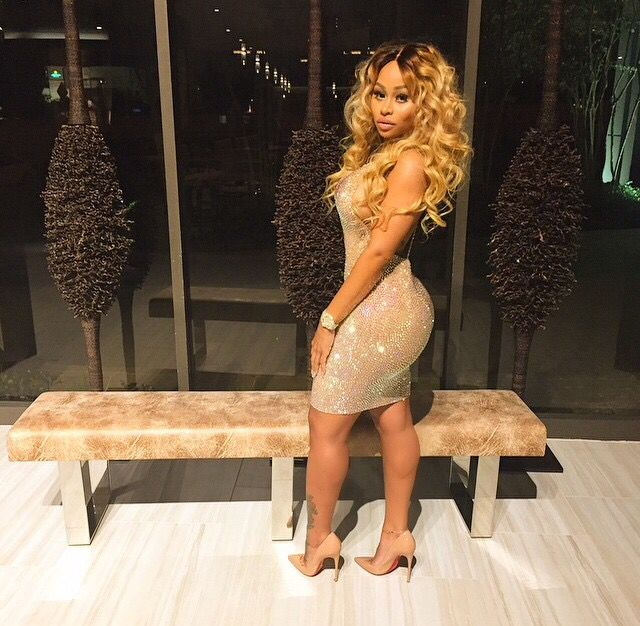 Gold Glitter Bodycon Dress Blonde Curly Hair Weave Hairstyle Middle Parting Louboutin Heels Red Bottom Stunning Beautiful Black Women Curves Blac Chyna