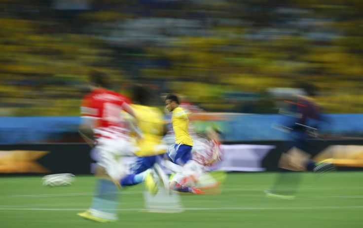 Brazil's Neymar runs for the ball during their 2014 World Cup opening match against Croatia at the Corinthians arena in Sao Paulo June 12, 2014.