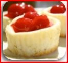 White Chocolate Cherry Cheesecake Cupcakes  Vanilla wafers1 pkg  WHITE CHOCOLATE CHERRY VANILLA DESSERT MIX  1 x 8 oz brick cream cheese (250g), softened  1 cup Cool Whip      Place vanilla wafers in paper lined muffin cups. Combine one packet of WHITE CHOCOLATE CHERRY VANILLA DESSERT MIX with cream cheese and Cool Whip.  Pour into muffin cups.  Refrigerate for a couple of hours or overnight.  Garnish with a maraschino cherry or cherry pie filling