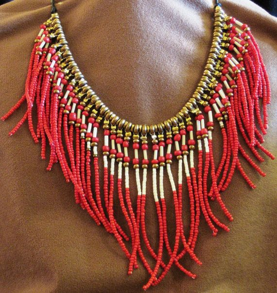 Rusty-red, cream and gold seed beads with cream bugle bead strands on brass disks. 18 long. Longest fringes are about 3 3/4 long. Strung on