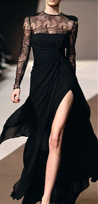 Wonderful black thigh-high split gown with lace detailing along the neckline and sleeves, and the heavier shoulder pieces.