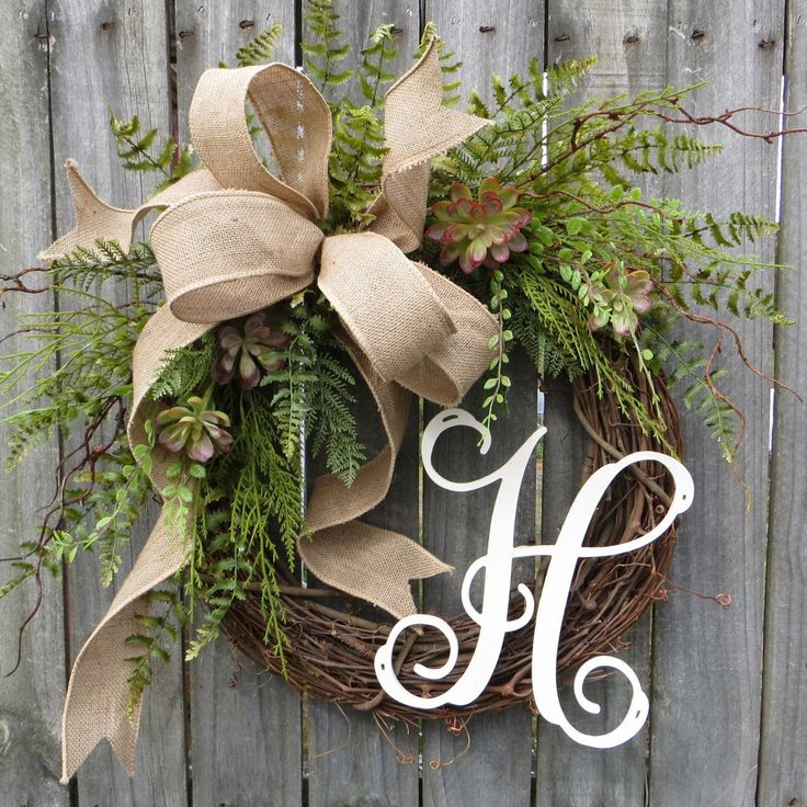 This wreath is the perfect accent for a sheltered front door or interior space. A wild wired burlap bow is surrounded by realistic succulents and