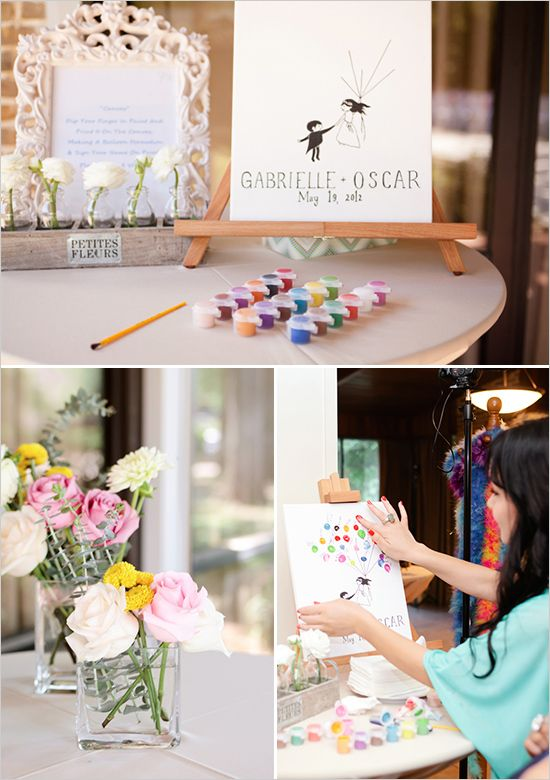 fingerprint painted guest book - super cute and meaningful