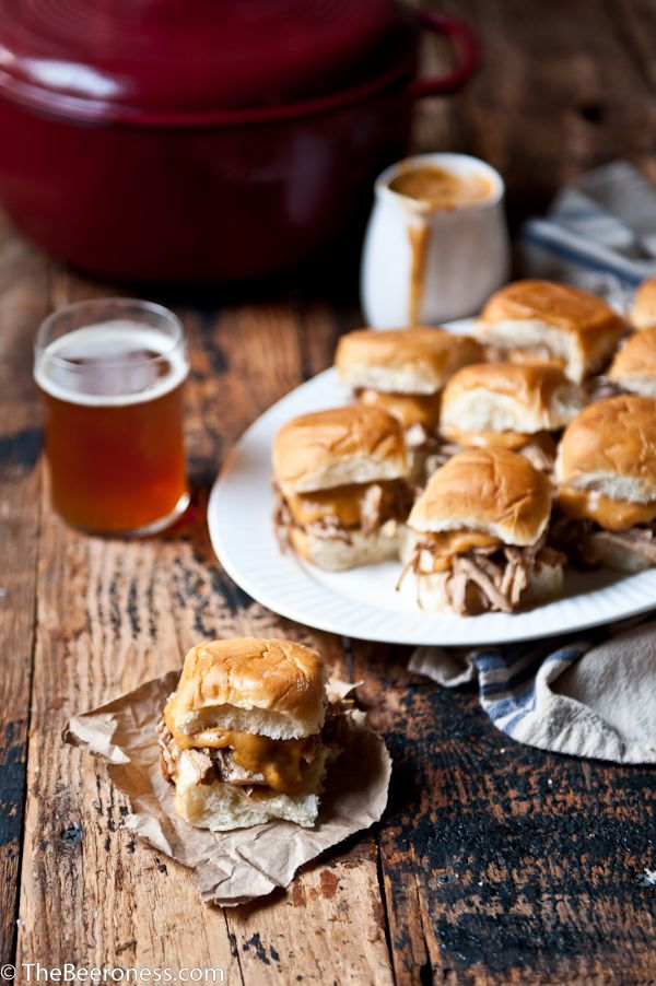Beer Braised Pulled Pork Sliders with Chipotle Beer Cheese Sauce. Perfect football food!
