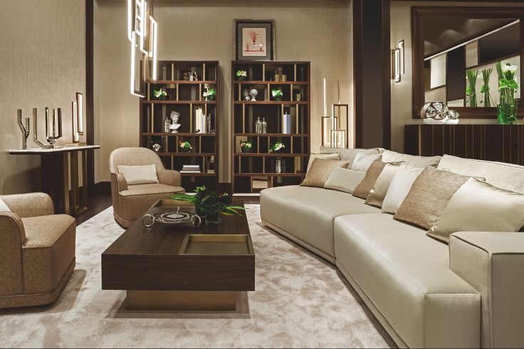 "The ""Symphony in Beige"" living and dining room by Oasis features a Dahlia sofa, Yves small tables, two big Magritte bookshelves, perfect for book of any size, and a Saint-Germain console. The light is provided with Edge lamps, suspension, floor and wall versions."