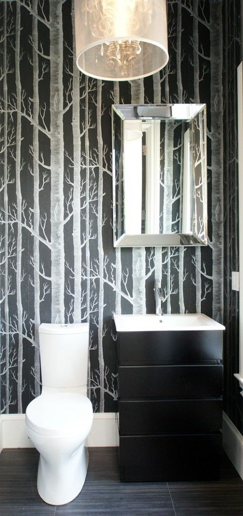 modern bathroom wallpaper... kind of like the trees... this version is a little much though also like the sink/black drawers