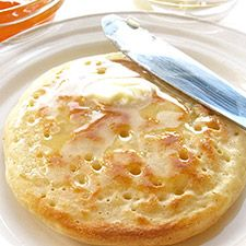 Crumpets: British teatime treat, midway between an English muffin and pancake.Slather with butter and honey | http://www.kingarthurflour.com/recipes/crumpets-recipe
