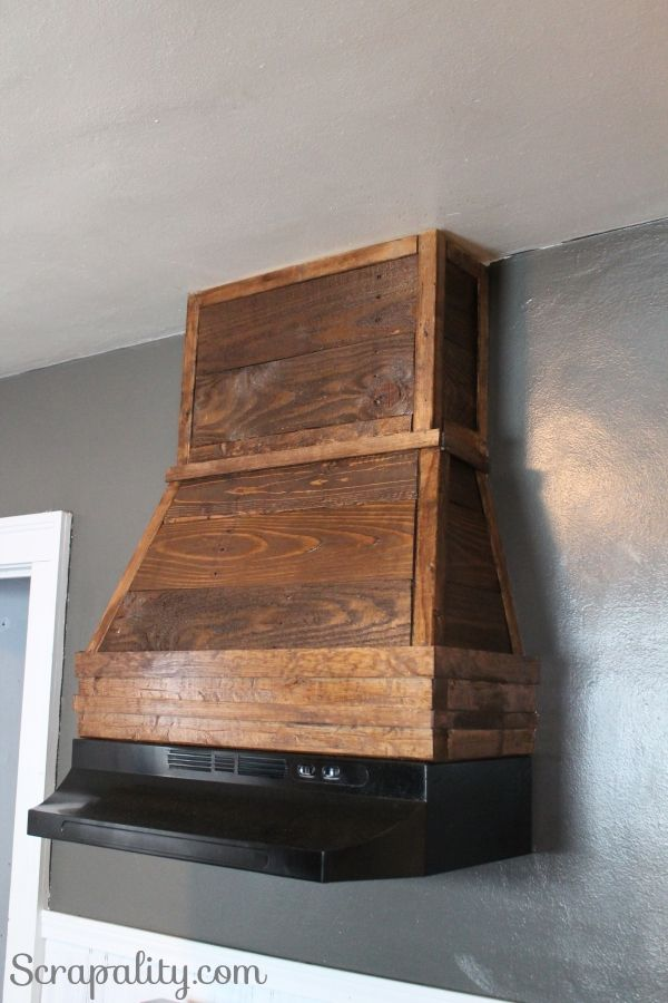Wood Chimney Hoods ~ Pallet wood adds a rustic style to kitchen hood custom