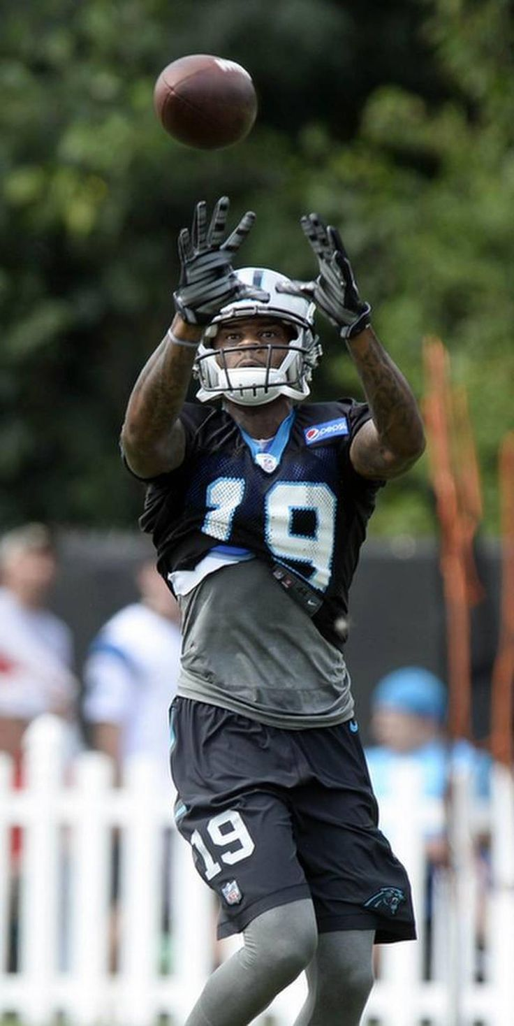 Carolina Panthers' Ted Ginn, Jr (19) reaches up for a reception during Carolina Panthers Training Camp at Wofford College in Spartanburg, SC on Sunday, August 9, 2015.