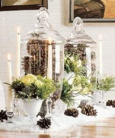 Pinecone filled apothecary jars on the guestbook table could be cute or as a centerpiece with candles. Looks easy. Fake snow..
