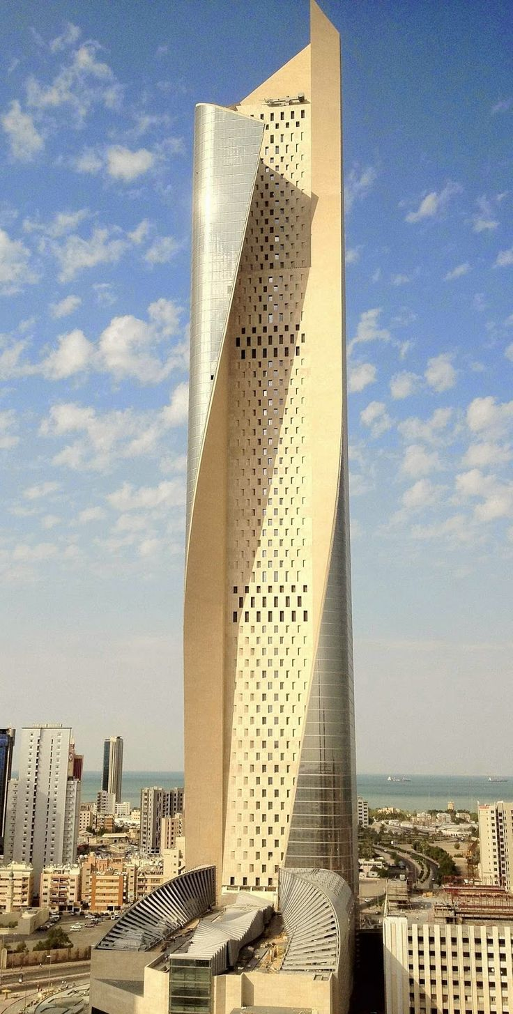 The Al Hamra Tower Kuwait City. Opened: 2011. It's design is meant to limit the solar gain within the tower, wrapped section of the tower acting as a shading device and the stone center part of the tower with limited openings to limit the Sun.The rest of the tower is clad in glass, allowing for natural light to enter in (using northern light). Designed by Skidmore, Owings, and Merrill. The tower is the tallest building in Kuwait as well as being the tallest sculpted tower in the world at…
