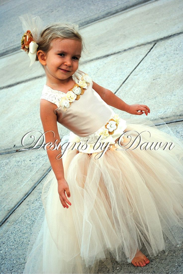 Custom Made Champagne Flowergirl Dress. Corset top, tutu skirt with train and hair clip. Size 12m-5T. Custom sizes and colors available. $85.00, via Etsy. In love with this dress!