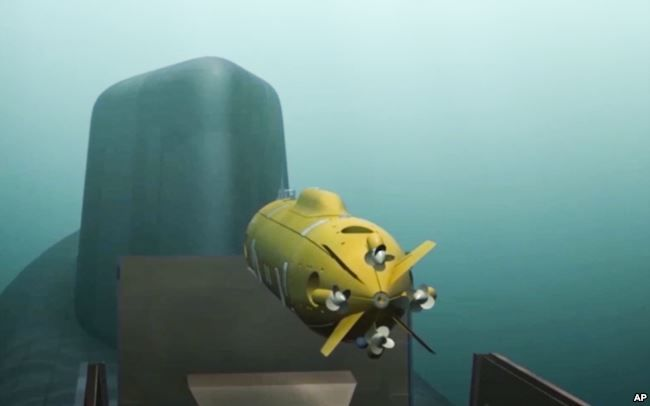 In this video grab provided by RU-RTR Russian television via AP television on March 1, 2018, a computer simulation shows a Russian nuclear-powered underwater drone being released by a submarine.