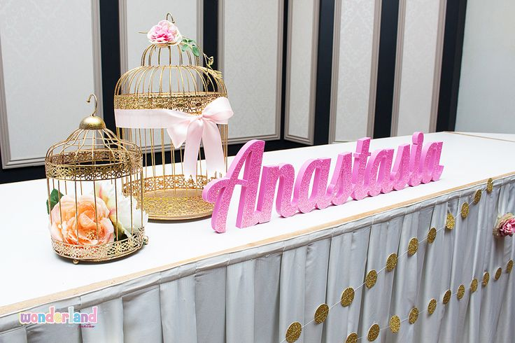 Party styling gold birdcages with flowers -www.wonderlandparties.com.au