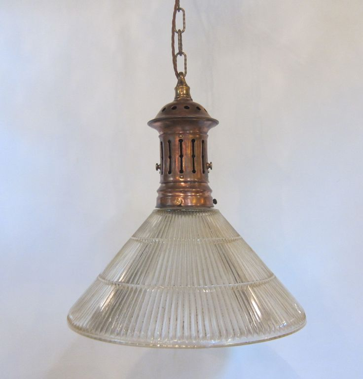 Large english pendant light in the original copper finish complemented by period holophane glass shade