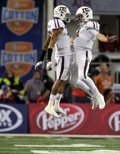 Texas A & M quarterback Johnny Manziel (right) celebrates with defensive back Dustin Harris after the Aggies scored a touchdown in the third quarter of the AT Cotton Bowl Classic, Jan. 4, 2013, at Cowboys Stadium. A & M beat Oklahoma 41-13. (Louis DeLuca)