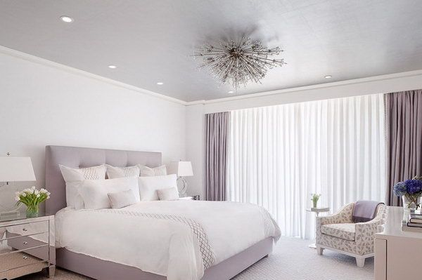 Grey purple Color for a Tumblr Feel. This simple bedroom with the Lilac color palette is so soothing yet chic.  The details: The light fixture, curtain and sheer track concealed behind a bulkhead, the lavender ceiling, the mirrored night stand, the bedding.
