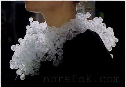 Hong Kong- born, Nora Fok, uses nylon fishing line to make complex jewellery inspired by a variety of natural forms. Her delicat...