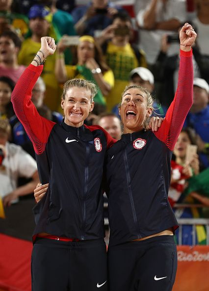 Bronze medalists Kerri Walsh Jennings and April Ross of the United States pose…