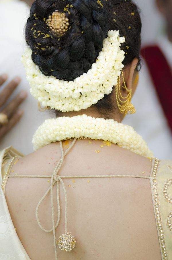 South Indian bride. Temple jewelry. Jhumkis.White silk kanchipuram sari.Bun with fresh jasmine flowers. Tamil bride. Telugu bride. Kannada bride. Hindu bride. Malayalee bride.Kerala bride.South Indian wedding.