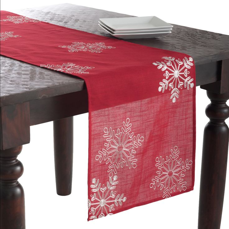 Features:  -Material: Polyester.  -Embroidered snowflake design runner for a contemporary holiday entertaining.  Color: -Red; Silver.  Material: -Polyester.  Pattern: -Holiday.  Holiday Theme: -Yes.