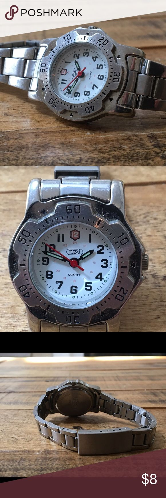 Ladies dive style watch This lady's dive style watch by Tozaj is a great accessory for the beach, and long summer days. Shows some minor desk wear and scratching on the stainless steel portions of the watch, but is in otherwise excellent condition. Works perfectly and comes with a new battery installed. Accessories Watches