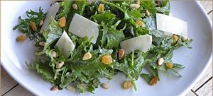 Baby Kale Salad with Golden Raisins, Pine Nuts and Gouda