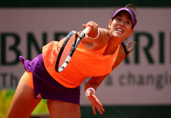 Garbine Muguruza of Spain serves during her women's singles match against Serena Williams of the United States on day four of the French Open at Roland Garros on May 28, 2014 in Paris, France.