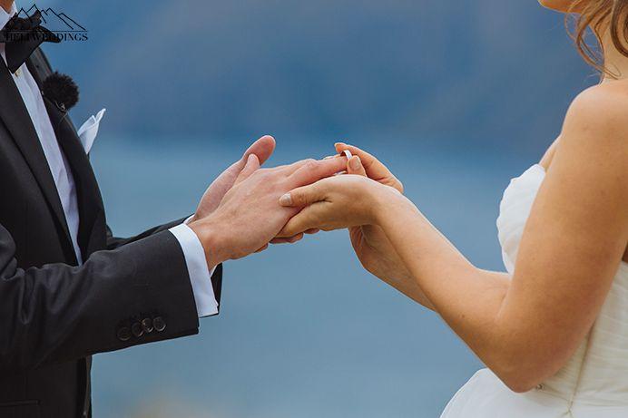 Bride and groom exchange rings at Coromandel Peak wedding. Heli wedding Wanaka New Zealand