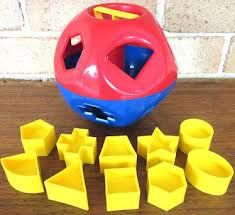 Tupperware toy from the 70's.  A great teaching toy.  Eye had coordination and shape identification.