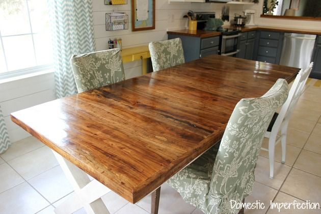 pecan dining table - love the surface (not the chairs or under table)