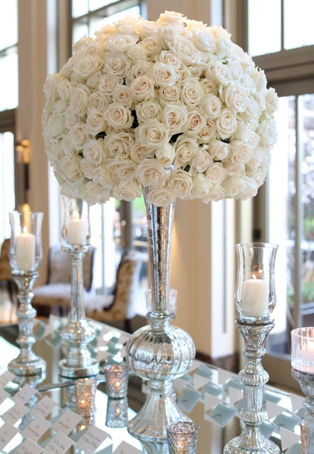 Ivory Roses Escort Card Table Wedding - Too many roses, but good look with candles, mirror plates, etc