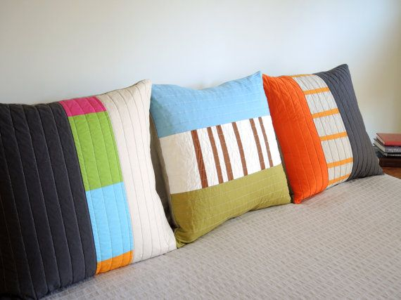 Lots of color here, but never overwhelming.  20 square pillow cover divided in 3 panels - 2 solid and 1 pieced in random stripes.  Envelope closure.