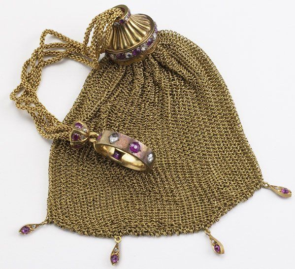 MESH CHATELAINE PURSE WITH DIAMONDS AND RUBIES :MESH CHATELAINE PURSE WITH DIAMONDS AND RUBIES Ca. 1900. 18k yg finger ring set with alternating rose cut diamonds and cushion cut rubies suspends draw-chain purse, with gem set chain terminal, trumpet-form slide and fringe, unmarked. Diamonds: approx. 1 ct. TW. 89.6 gs. Lot 1076