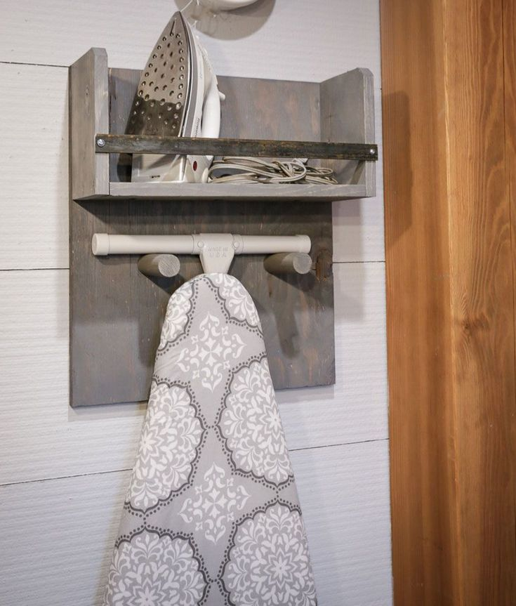 Here's a beautiful and accessible way to store your iron and ironing board. This simple to build iron board holder is a very easy DIY project that is guaranteed to up the form and function in your lau