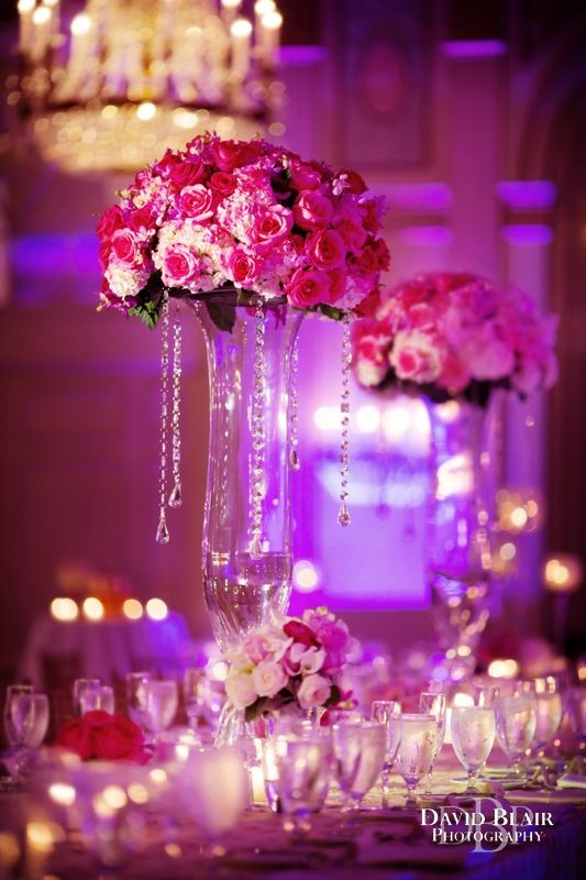 vibrant pink rose centerpieces with up lighting at the brown hotel in louisville kentucky