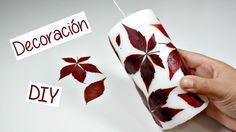 Dale un toque decorativo a tus velas a partir de hojas recogidas en un paseo por el parque.