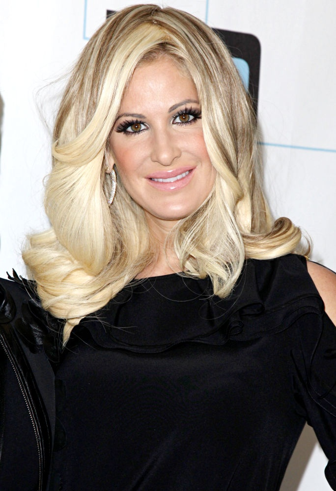 Kim Zolciak - Housewives of Atlanta - single mom of two daughters who had a sugar daddy but now married to younger football player.  Has two sons with him.