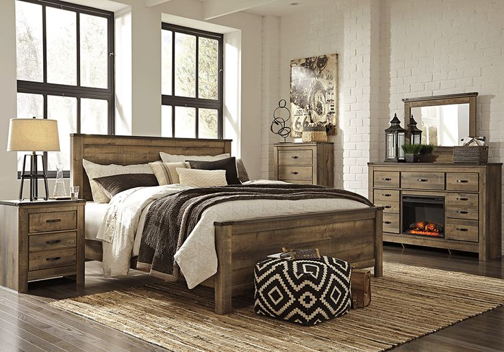 Whether she loves horses or he's a cowboy at heart, Trinell king bedroom set matches their authentic sense of style. Rustic finish, plank details and nailhead trim are an homage to reclaimed barn wood, making for a sophisticated, vintage-chic look. A built-in charging station for tablets, cellphones and other electronics offers an up-to-date convenience.