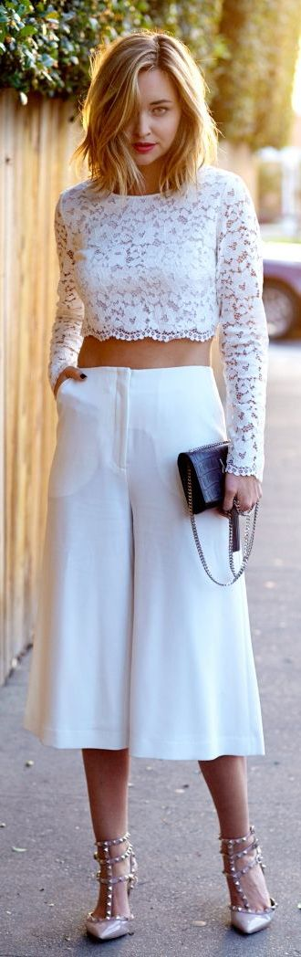 Culotte Shorts Outfits & Ideas: Liz Cherkasova is wearing a pair of Elizabeth & James white culotte shorts