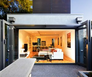 A sleek, contemporary residential renovation to an existing single fronted Victorian terrace house in South Yarra, Melbourne. Landlocked on both sides and restricted by council and heritage stipulations, the brief required new rear open plan living kitchen backing onto courtyard, along with adding a new uppers storey for master bedroom, with WIR and ensuite and external balcony deck
