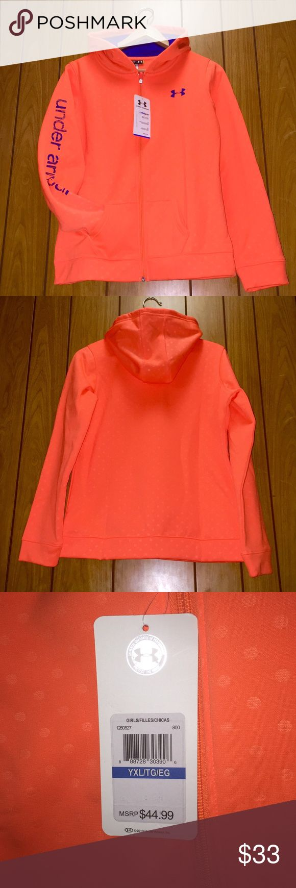 💥SALE💥Under Armour orange sweatshirt hoodie S Very unique sweatshirt from Under Armour with a polka dot pattern on a bright orange background. Tag reads Youth XLarge which is an equivalent of a Small in women sizing. I am a Small or XSmall, and this shirt fits me well with a loose and comfortable fit. The shirt is lined with a warm and cozy fleece. All details such as a lining of the hood, front logo, and lettering on the right sleeve are in royal blue. It has a full length zipper and two…