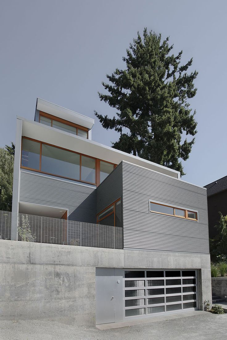 Seattle modern home with corrugated metal siding and terraces