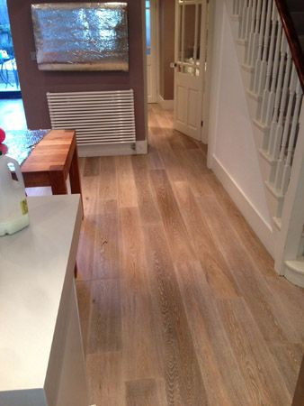 8 best wood effect plank tile installation in shoreditch for Is it ok to put hardwood floors in a kitchen