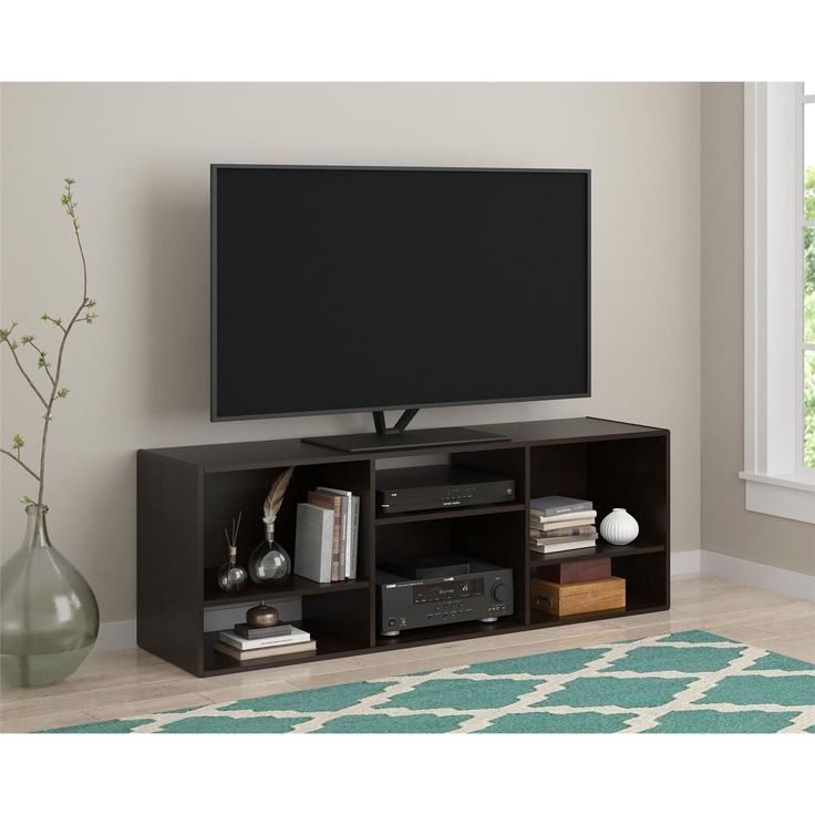 The smartly designed Altra Nash 55 inch TV Stand/ Bookcase can be used to fit your space however you need it. Use this item vertically as a Bookcase. When used horizontally, this item holds up to a 55 inch flat screen TV.