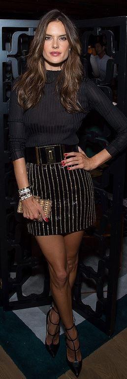 Who made Alessandra Ambrosio's black belt, gold jewelry, beaded skirt, and crystal clutch handbag?