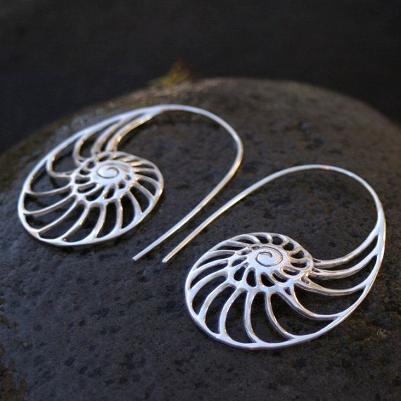Gorgeous nautilus shell design in silver. Wonderfully crafted organic beautiful and unique earrings. For all standard size piercings. SIZE: 1.75 long and