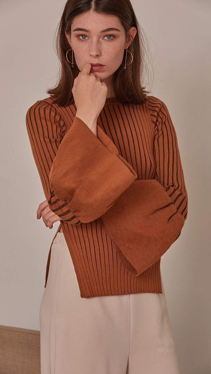 Etre Sweater in Brown. Oversized puffs on exaggerated cuffs, rib knit in the avant-grade silhouette. Voluminous bell sleeves in cropped length top with side slit. Rounded hem. Super soft feel. Designe