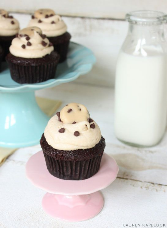 Triple cookie dough goodness! Cupcakes filled with chocolate chip cookie dough, topped with cookie dough icing and a small morsel of cookie dough garnish! Created by Lauren Kapeluck.