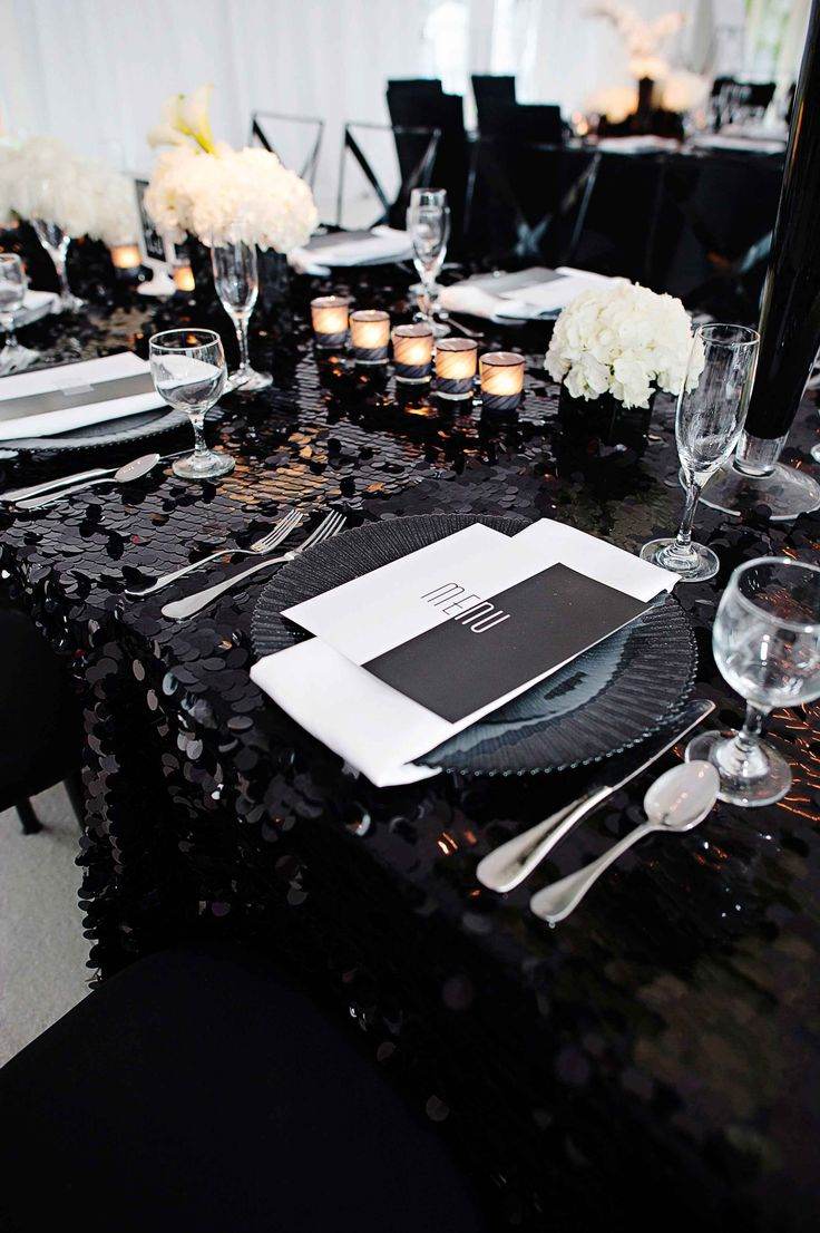 The place setting was topped with a modern, black & white menu. Photography: Kortnee Kate. Read More: http://www.insideweddings.com/weddings/black-and-white-modern-wedding-with-unique-details-in-cincinnati/698/